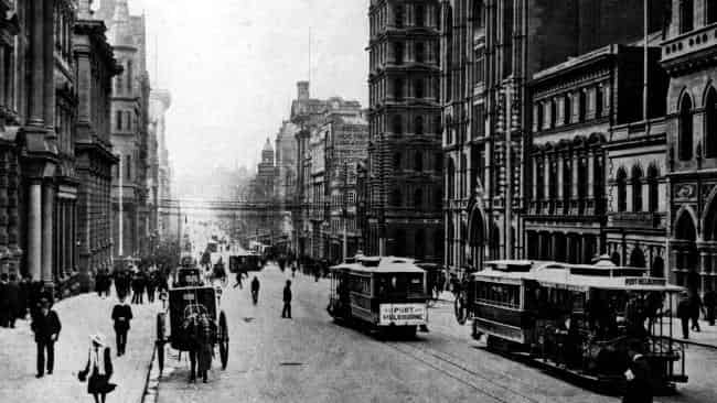 Cable trams running up Collins Street in 1910. The first cable tram started operating in 1885. Picture: HWT Library.