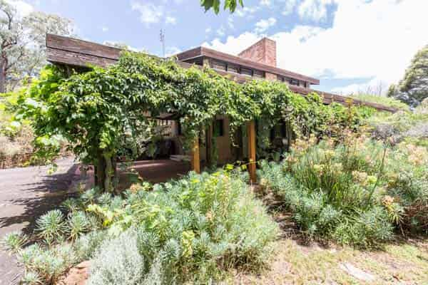 Green house, Harley St, Strathdale, Bendigo, Victoria. Mud brick house designed by Alistair Knox job number 685 plan dated March 1973