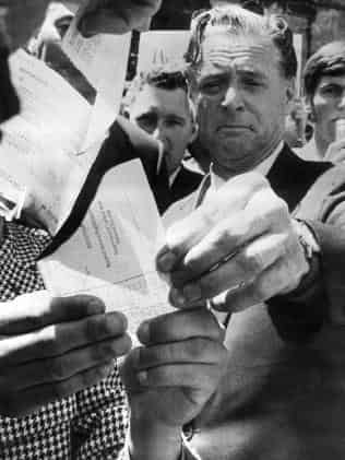 Dr Jim Cairns burns a draft card in the Melbourne Civic Square during a November 1969 protest. Picture: HWT Library