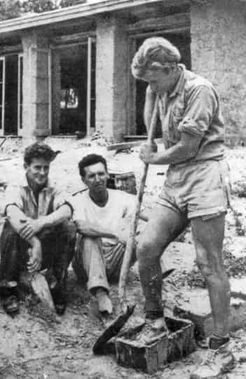 Gordon Ford, ably assisted by Alistair Knox and Tony Jackson, making mud bricks on an early Alistair Knox house
